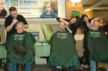 Students shave their heads to support childhood cancer research during the annual St. Baldrick's event.